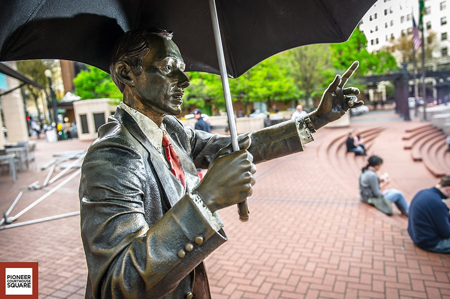Allow Me - Serving as a signature Portland icon, this bronze life-sized sculpture of a man offering his umbrella, was created by nationally known artist J. Seward Johnson of Princeton, New Jersey. The sculpture joins a number of Johnson